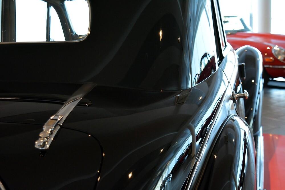 Back side of a classic black car by oanaunciuleanu