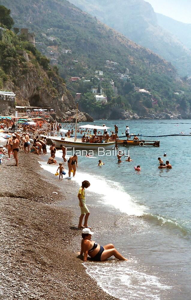 Lady on a beach in Positano, Italy by Elana Bailey