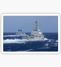 USS Carney practices diversion tactics with the German frigate Sachsen. Sticker