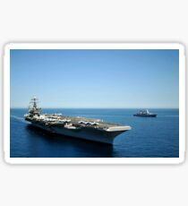 USS Harry S. Truman cruises alongside the German Navy frigate FGS Hessen. Sticker