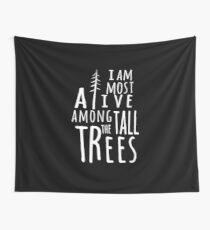 I AM MOST ALIVE AMONG THE TALL TREES Wall Tapestry
