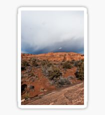 Approaching storm clouds over red rocks in Utah Sticker