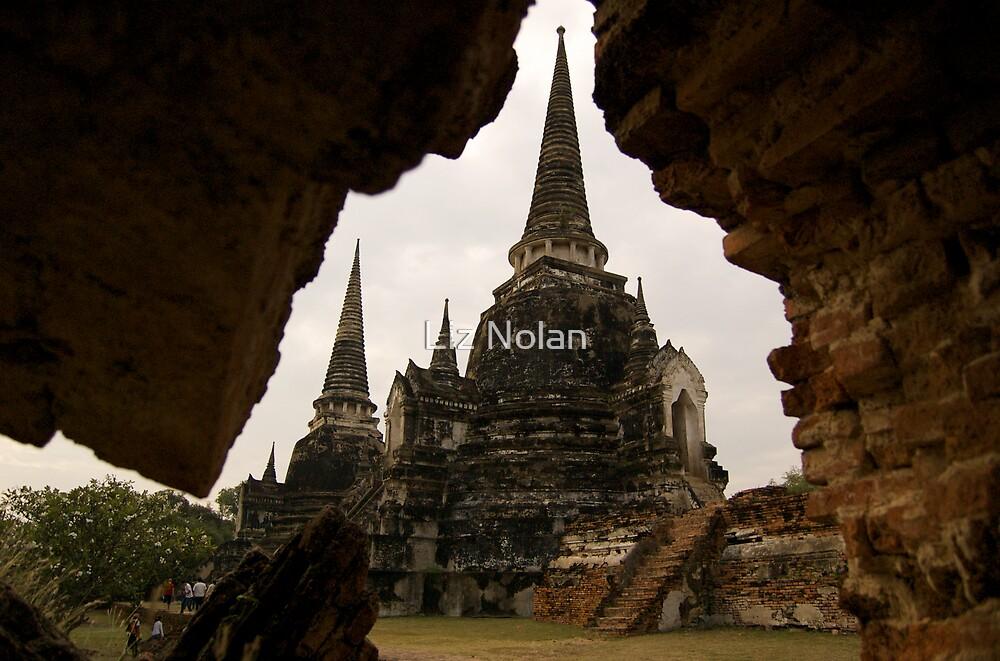 Ancient temple through aperture in ruins by Liz Nolan
