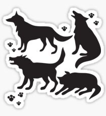 Hand drawn sketch set of wolves silhouettes on white background. Sticker