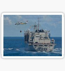An MH-60S Sea Hawk conducts a vertical replenishment with USNS Bridge. Sticker