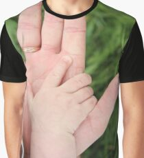 Father Holding baby hand. Concept of parental love or father's day. Graphic T-Shirt