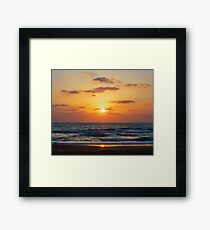 Reflection of the setting sun in sea water Framed Print