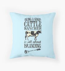 Being a Good Cattle Rancher is all about Branding Throw Pillow