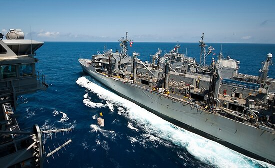 USS Nimitz, USNS Rainier, and USS Princeton transit the Pacific Ocean. by StocktrekImages