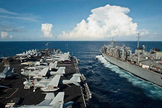 USS Nimitz and USNS Rainer transit alongside each other. by StocktrekImages