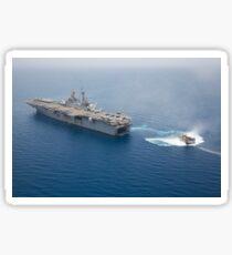 A landing craft air cushion approaches the well deck of USS Kearsarge. Sticker