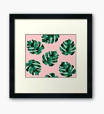 Tropical fern leaves on peach Framed Print