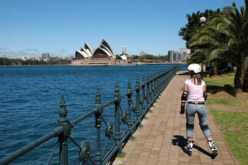 Girl rollerblading along the Sydney Harbour foreshore with the Opera House in the background by rollerblading