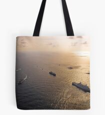 A multi-national naval force navigates the waters of the Caribbean Sea. Tote Bag