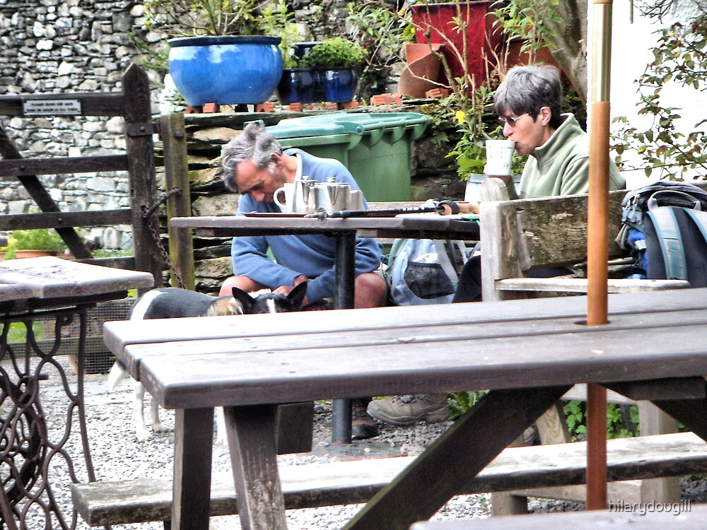 Candid shot of a couple in the cafe with their dog by hilarydougill