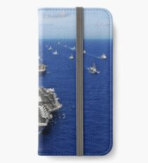 Aircraft carrier USS Ronald Reagan transits the Pacific Ocean with a fleet of ships. iPhone Wallet/Case/Skin