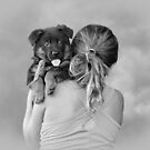 Young Girl and Puppy by Sandy Keeton