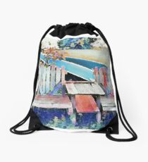 Two Heart-Shaped Chairs with Two Canoes in the Background Drawstring Bag