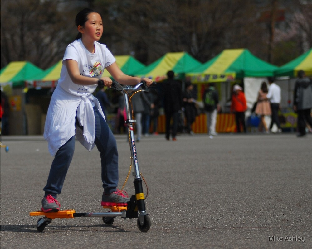 Korean Girl on 3 Wheeled Scooter by Mike Ashley