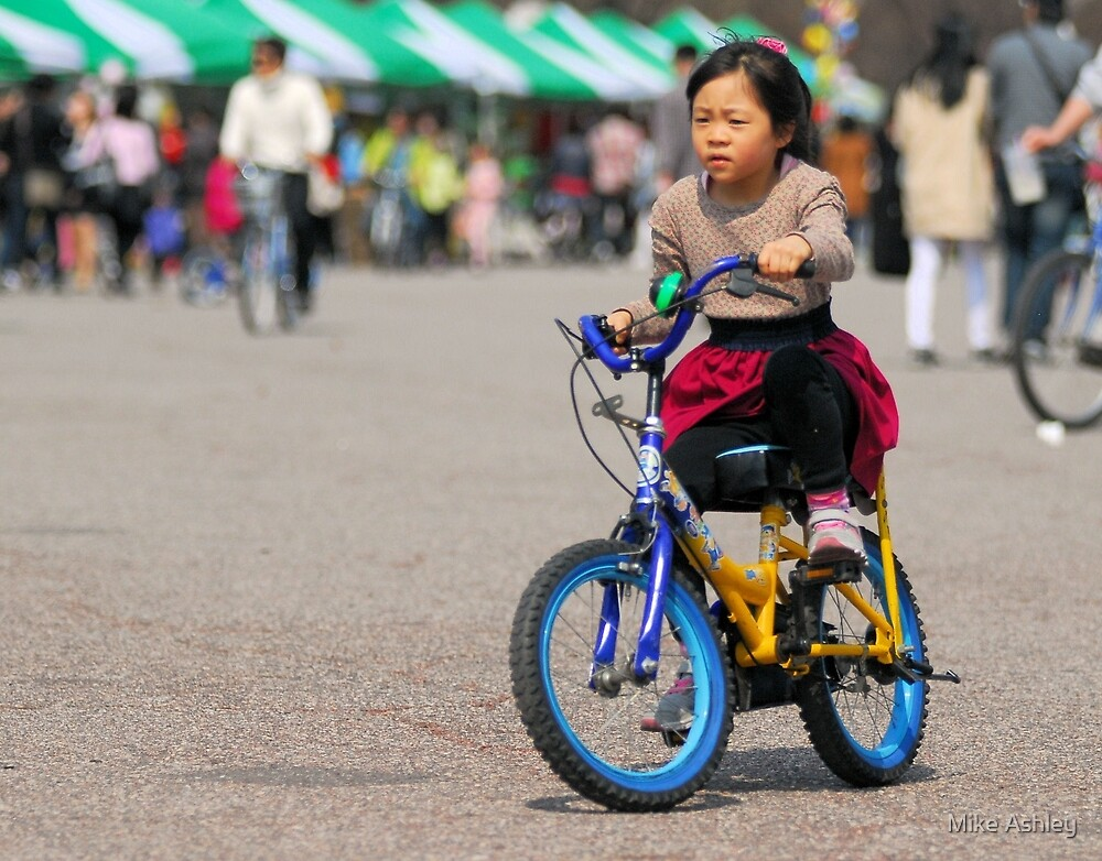 Little Korean Girl Learning to Ride a Bike by Mike Ashley