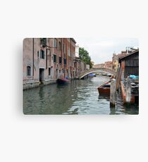 Canal in Venice, Italy, with boats and typical architecture  Canvas Print