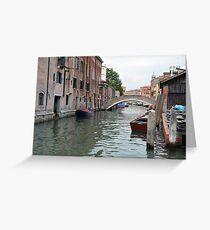 Canal in Venice, Italy, with boats and typical architecture  Greeting Card