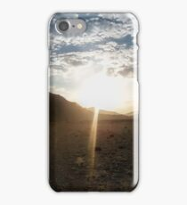 Sunset in the mountains, sunrays light up the clouds iPhone Case/Skin
