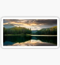 pine forest and lake near the mountain early in the morning Sticker