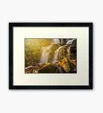 beautiful waterfall in sun rays Framed Print