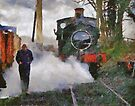 Engineer walking through steam from locomotive, East Somerset Railway, Shepton Mallet, UK by David Carton