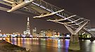The Shard and Millenium bridge at night by Delfino