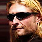 Young man with sunglasses by Kurt  Tutschek