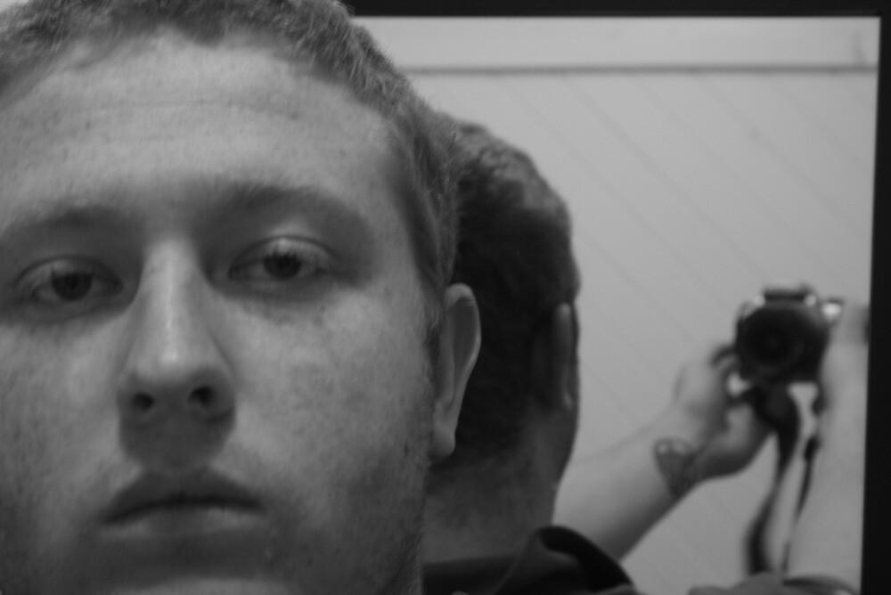 A very tired self portrait by Shane Elliott