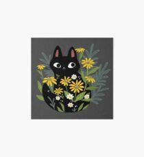 Black cat with flowers  Art Board Print