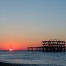 Brighton Piers Sunrise by Sue Robinson