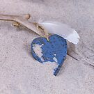 Blue Heart and feather on the Beach by artsandsoul