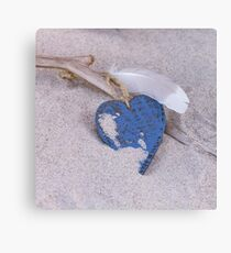 Blue Heart and feather on the Beach Canvas Print