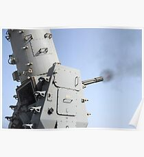 A close-in weapons system fires during an operational test aboard USS Vicksburg. Poster