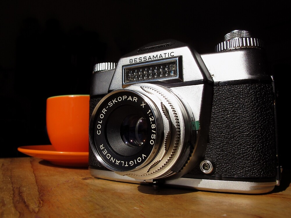 Vintage SLR and Coffee by wayneyoungphoto