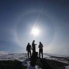 Hikers in sun halo by beavo