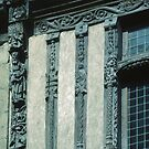 Detail of wood carving on C17 building Caen 19840819 0006  by Fred Mitchell