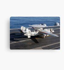 An E-2C Hawkeye makes a successful arrested landing aboard USS Kitty Hawk. Canvas Print