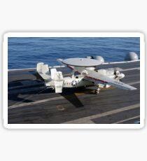 An E-2C Hawkeye makes a successful arrested landing aboard USS Kitty Hawk. Sticker