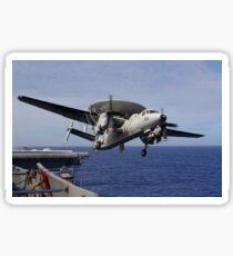 An E-2C Hawkeye launches from USS Kitty Hawk. Sticker