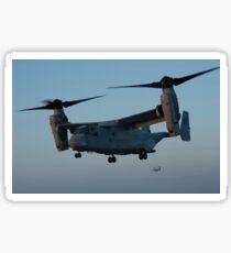 An MV-22 Osprey prepares to land on the flight deck of USS Anchorage. Sticker