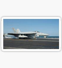 An F/A-18E Super Hornet launches from the flight deck of USS Harry S. Truman. Sticker