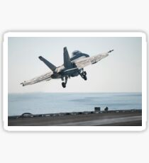 An F/A-18F Super Hornet launches from the flight deck of USS Harry S. Truman. Sticker