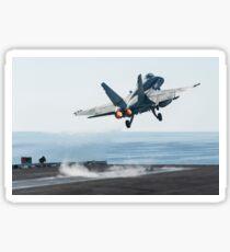 An F/A-18C Hornet launches from the flight deck of USS Harry S. Truman. Sticker