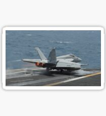 An F/A-18E Super Hornet launches off the flight deck of USS Nimitz. Sticker