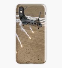 A U.S. Marine Corps CH-46 Sea Knight helicopter launching flares over the desert near Al Taqqadum, Iraq.  iPhone Case